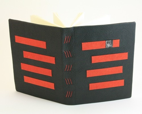 red and black leather bound hardcover