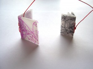 two wax covered miniature books