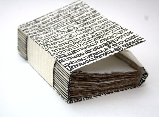 View of the binding of Chasing Infinity through the Vanishing Point by Hilke Kurzke